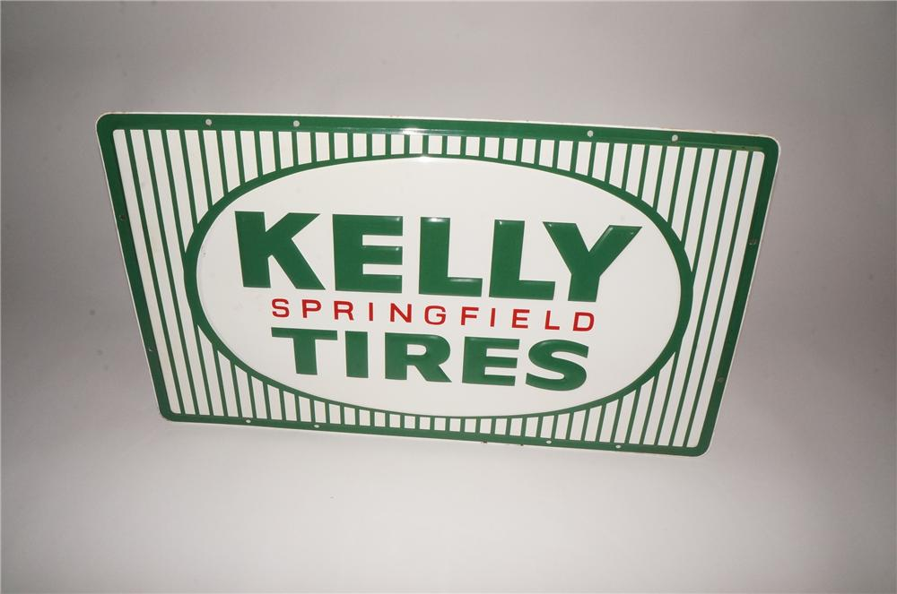 Striking N.O.S. 1960s Kelly Springfield Tires single-sided embossed tin garage sign with nice colors and design. - Front 3/4 - 133098