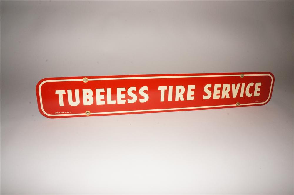 "Hard to find N.O.S. 1960s Firestone Tires ""Tubeless Tire Service"" tin sign. - Front 3/4 - 133104"