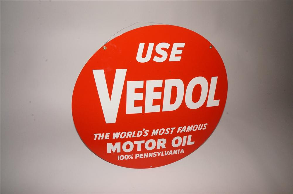 N.O.S. 1950s Veedol Motor Oil double-sided embossed tin garage sign. - Front 3/4 - 133109