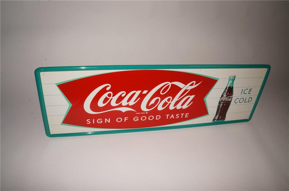 N.O.S. late 1950s-early 60s Coca-Cola Sign of Good Taste green fishtail tin sign with bottle graphic. - Front 3/4 - 133113