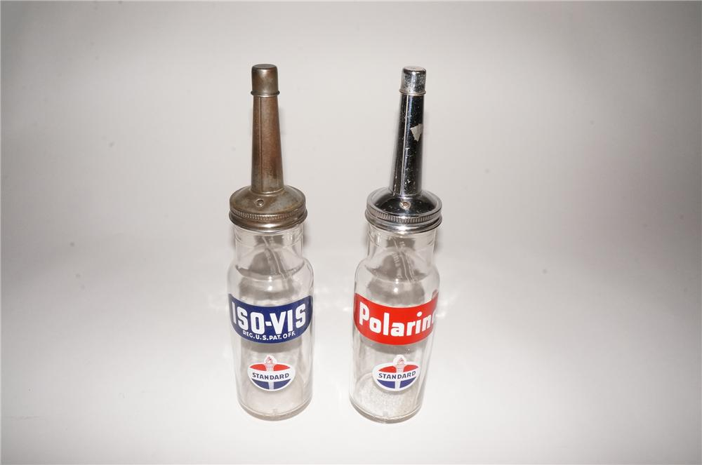 """Lot of two 1930s Standard Oil """"Polarine - Iso Vis"""" glass oil bottles with logos. - Front 3/4 - 133118"""