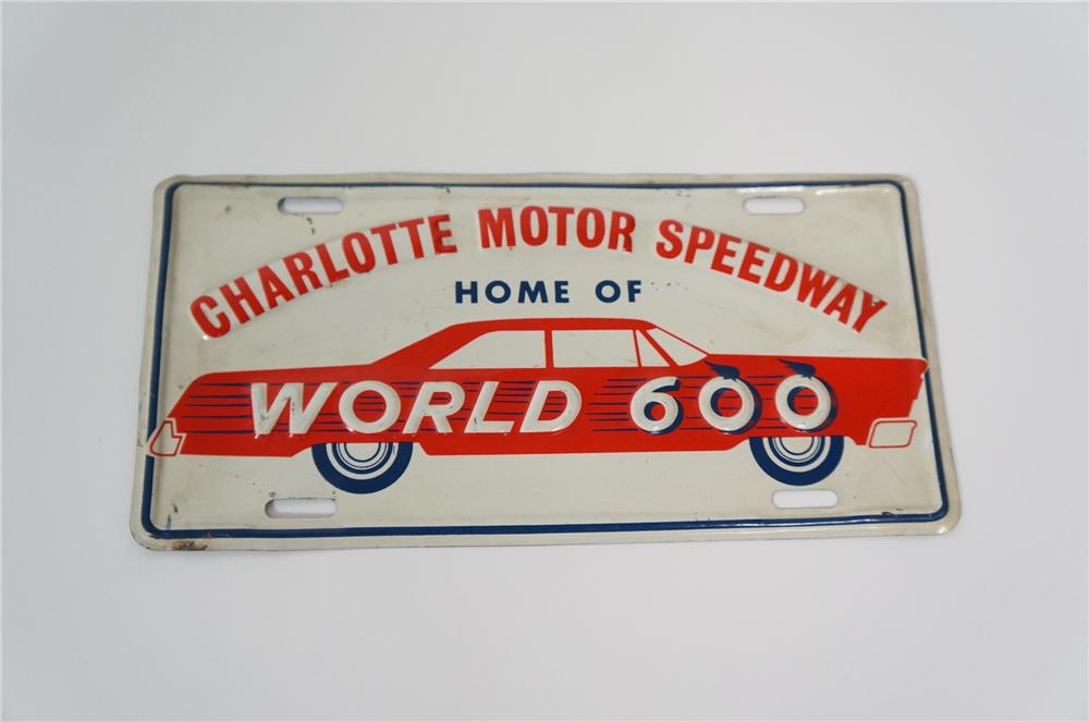 "Nifty 1960s Charlotte Motor Speedway ""Home of World 600"" tin license plate sign. - Front 3/4 - 133251"