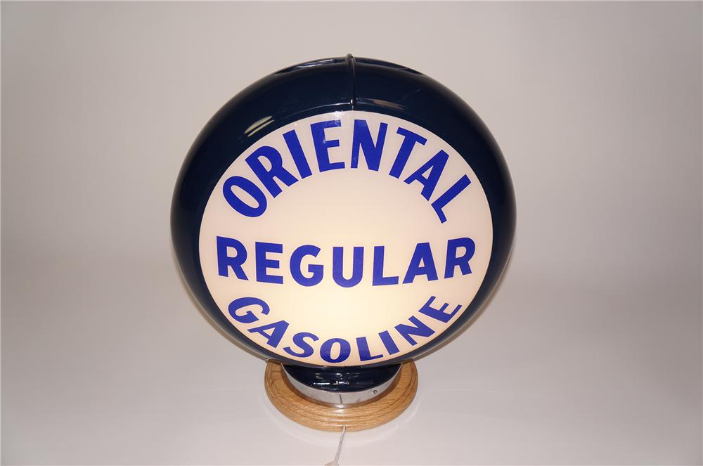 Hard to find 1940s-50s Oriental Regular Gasoline glass lens gas pump globe presented in a plastic body. - Front 3/4 - 133266