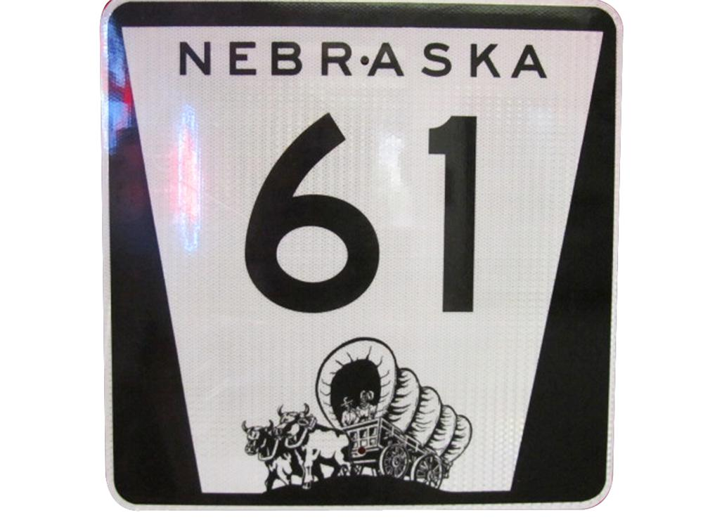 Highly desirable vintage Nebraska 61 metal highway road sign with Pioneer covered wagon logo. - Front 3/4 - 133349
