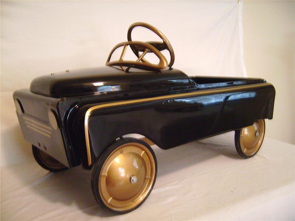 Fully restored and hard to find 1953 BMC pedal car coupe presented in black and gold stripes and wheels. - Front 3/4 - 133379