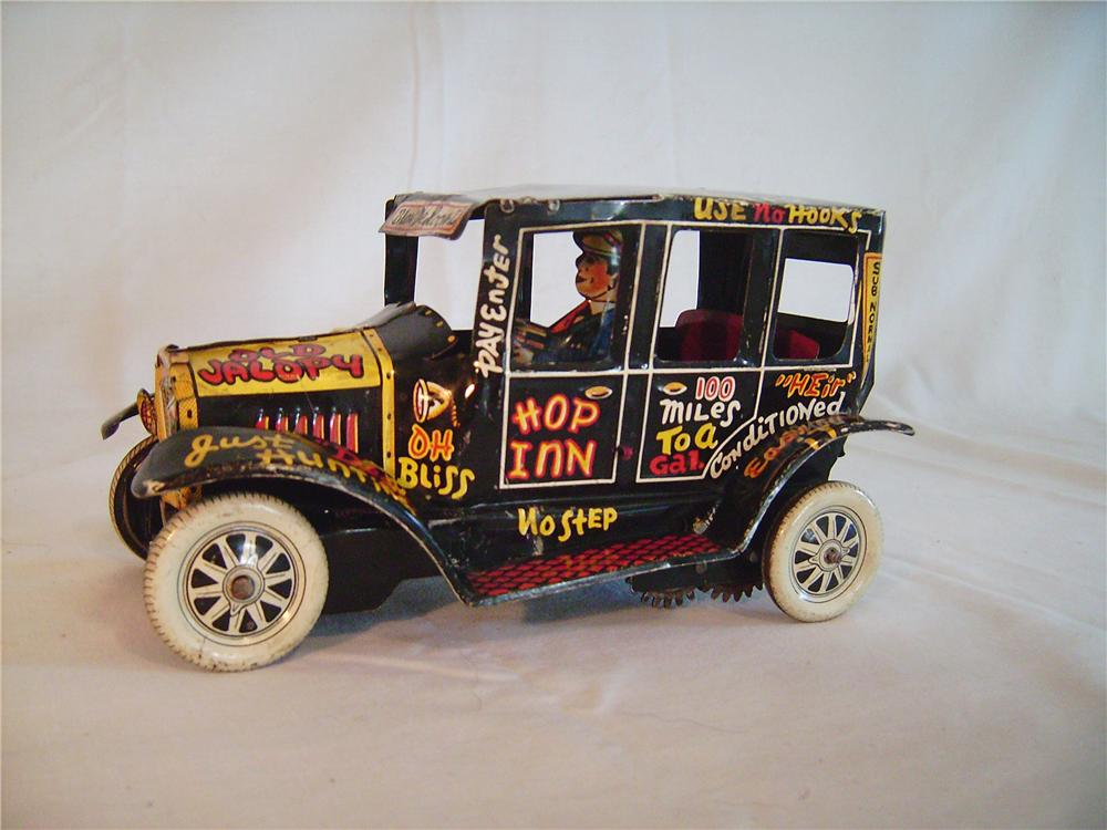 "1940s Louis Marx Toys ""Old Jalopy"" tin lithographic wind-up sedan with driver.   Very nice original. - Front 3/4 - 133392"