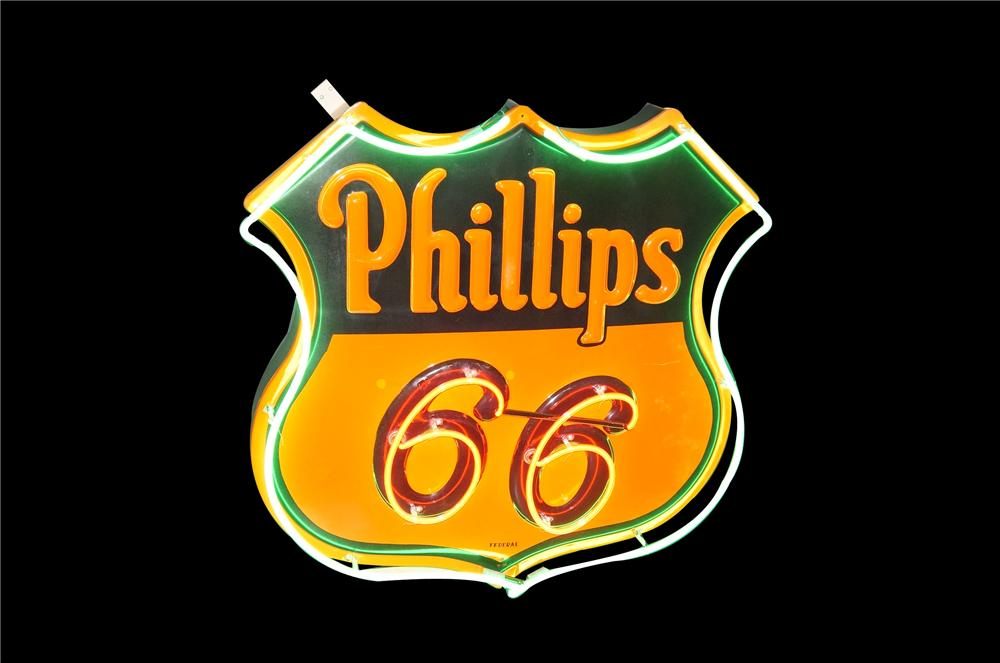 Spectacular 1955 Phillips 66 single-sided embossed porcelain service station neon sign. - Front 3/4 - 133443