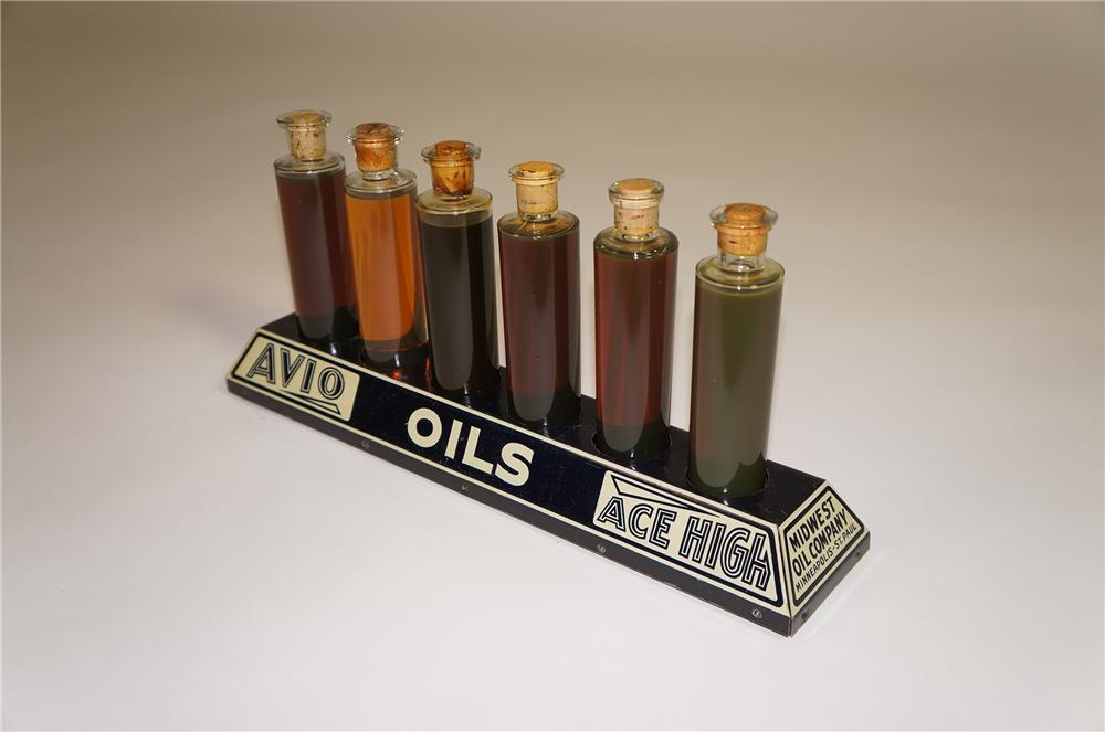 Rare late 1920s Ace High- Avio Oils filling station metal counter-top display with six period glass bottles filled with vari... - Front 3/4 - 138533