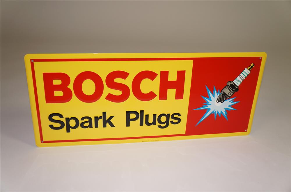 N.O.S. 1970s Bosch Spark Plug single-sided embossed tin garage sign with Spark Plug graphic. - Front 3/4 - 138562