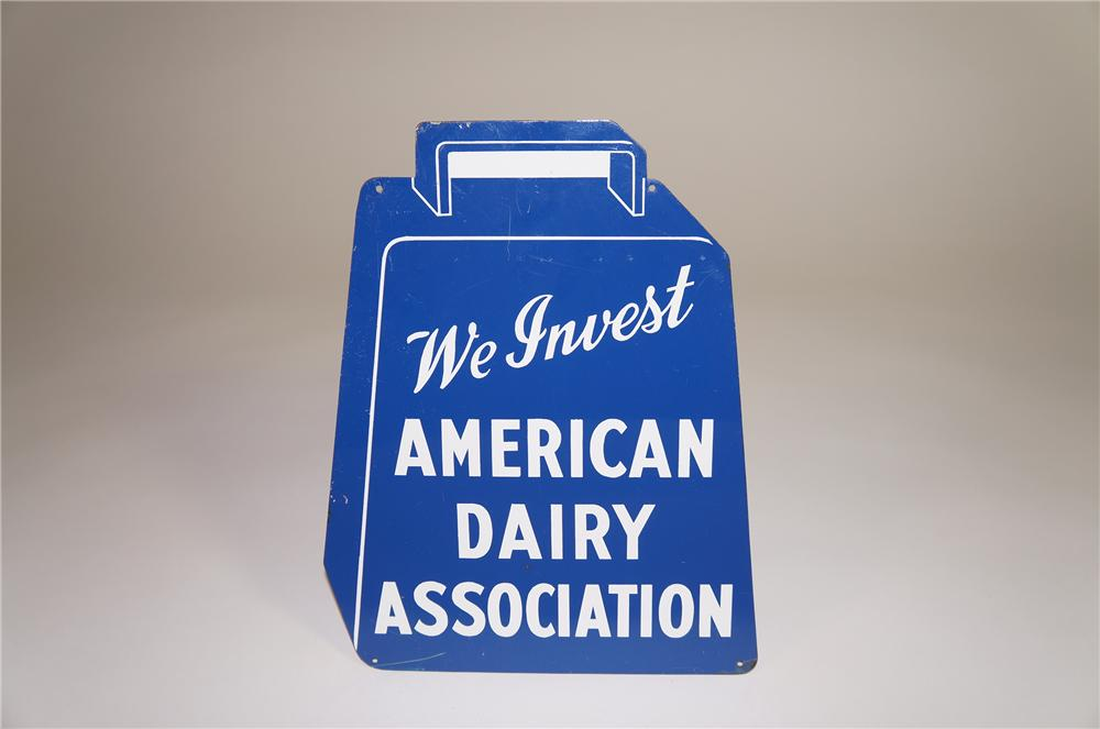 "1950s American Dairy Association ""We Invest"" cow bell shaped single-sided tin sign. - Front 3/4 - 138576"