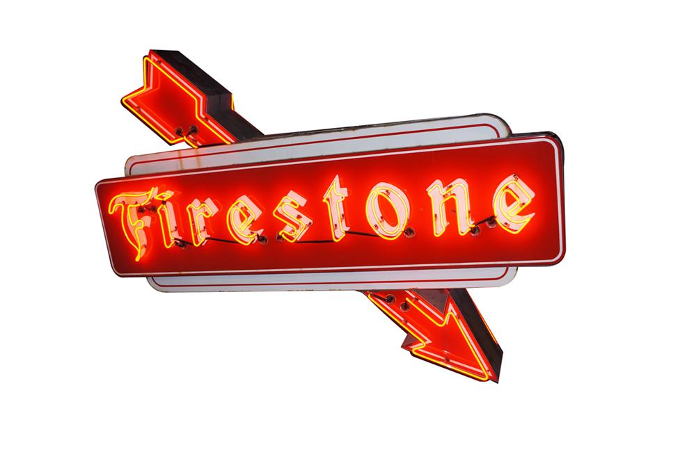 Phenomenal 1950s Firestone Tires double-sided porcelain neon automotive garage sign with arrows. - Front 3/4 - 138577