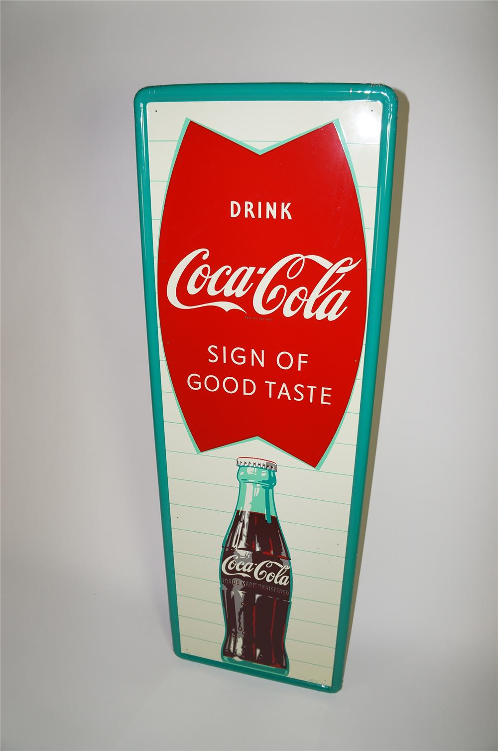 "N.O.S. late 1950s Coca-Cola Sign of Good Taste vertical green bordered fishtail sign with bottle graphic. Size 18""x54"" - Front 3/4 - 138665"