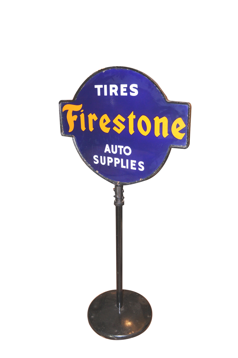 "Outstanding 1930 Firestone ""Tires - Auto Supplies"" double-sided porcelain curb sign. - Front 3/4 - 138697"