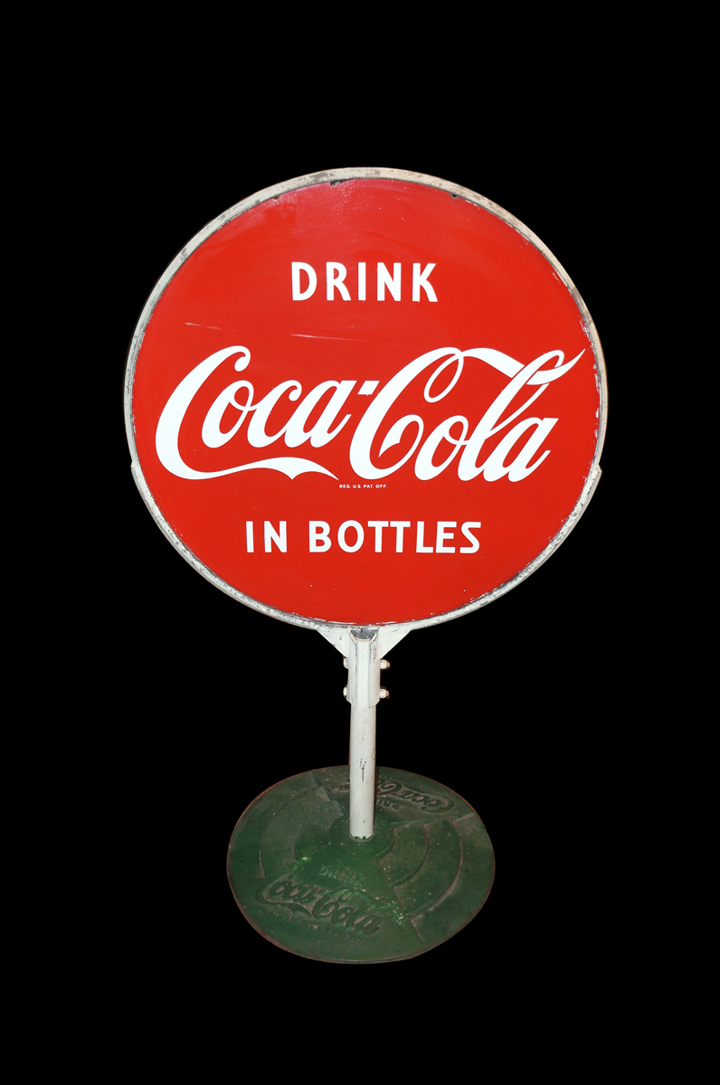 Outstanding 1950s Drink Coca-Cola in Bottles double-sided porcelain curb sign in original stand. - Front 3/4 - 138698