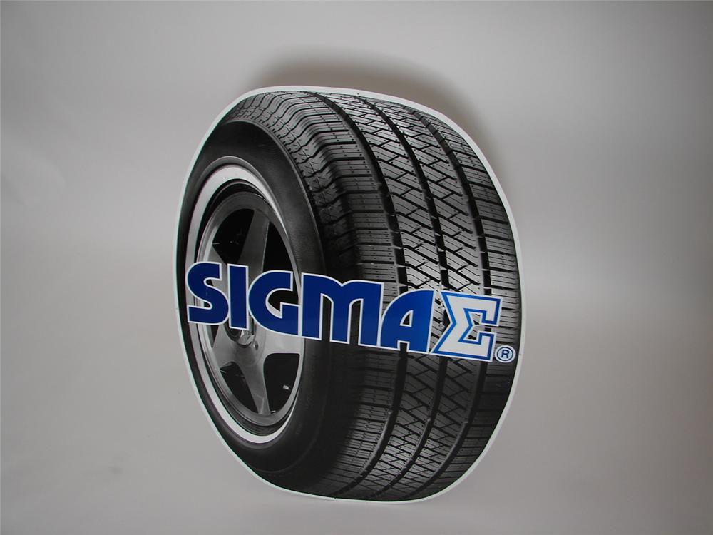 N.O.S. Sigma Tires single-sided die-cut tin tire-shaped garage sign. - Front 3/4 - 138903