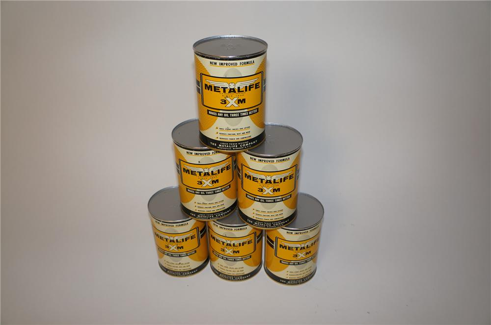 Lot of six N.O.S. 1940s-50s Metalife Oil Additive metal quart cans. - Front 3/4 - 139603