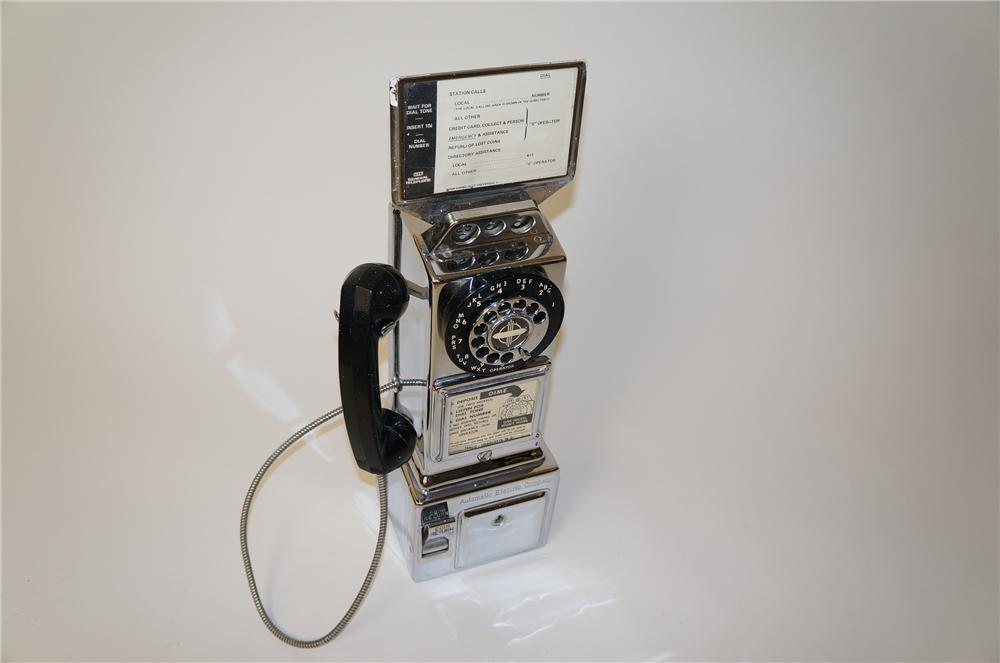 Very cool 1950s Automatic Electric Company chromed pay phone.  All original as found. - Front 3/4 - 139644