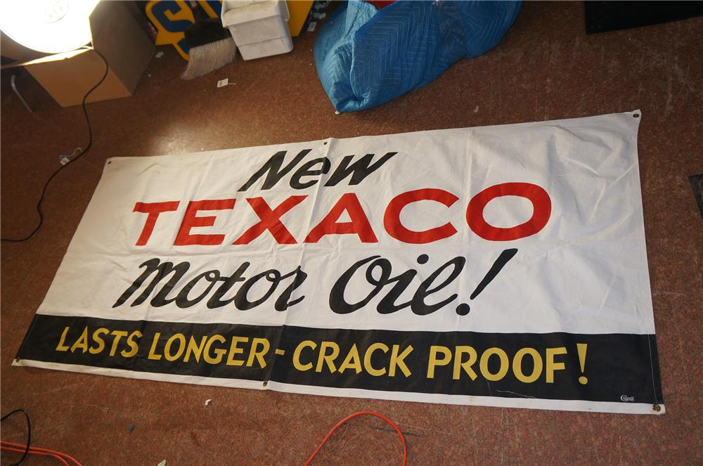 """Choice N.O.S. 1950s Texaco Oil """"Lasts Longer - Crack Proof"""" service station canvas banner. - Front 3/4 - 139649"""
