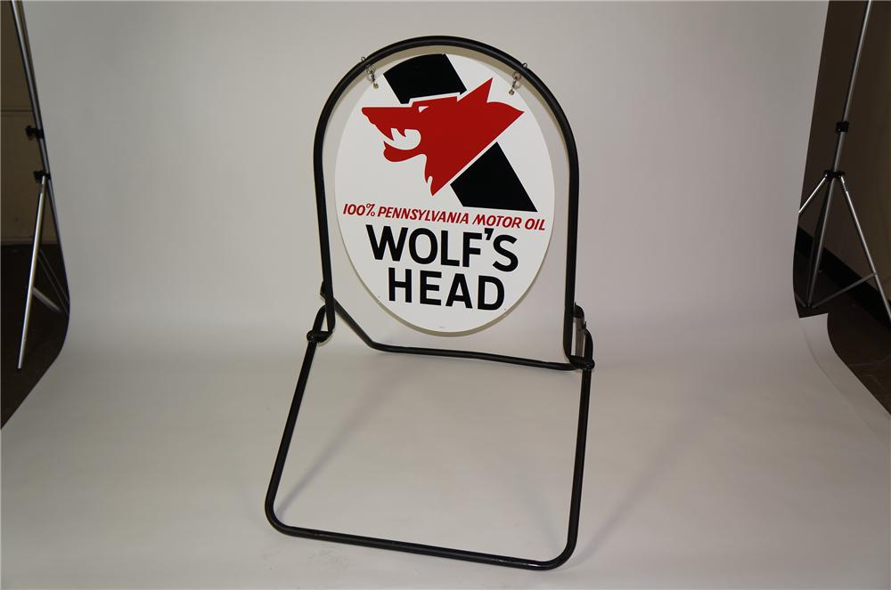 Impressive N.O.S. 1960s Wolfs Head Motor Oil double-sided tin painted curb sign in original stand. - Front 3/4 - 139682