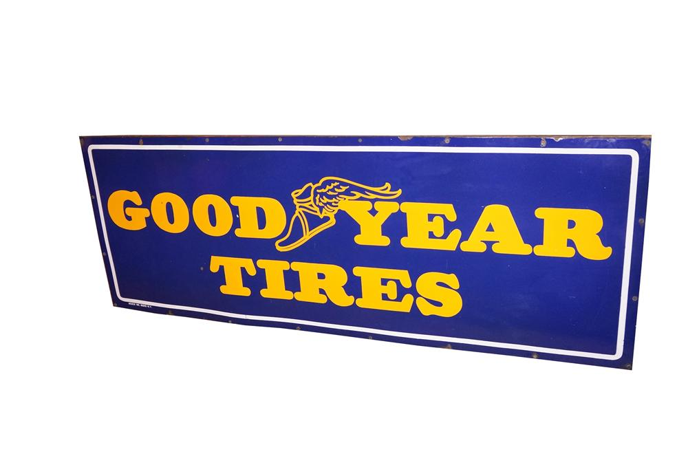 Wonderful large 1940s GoodYear Tires single-sided porcelain automotive garage sign with winged foot logo. - Front 3/4 - 139687