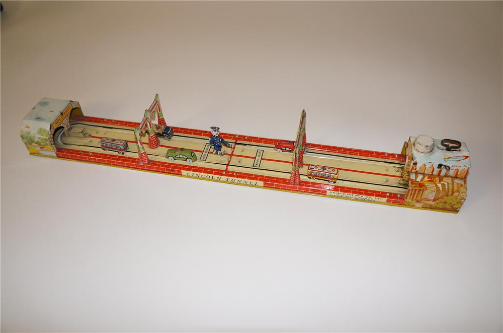 "Very neat 1930s Uniqie Art Mfg ""Lincoln Tunnel"""" tin wind-up toy with moving cars, buses and more. - Front 3/4 - 139706"