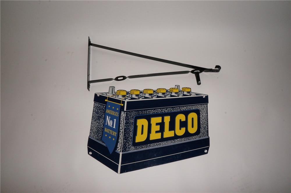 N.O.S. 1950s Delco Batteries double-sided tin painted battery shaped garage sign with hanging bracket. - Front 3/4 - 139755