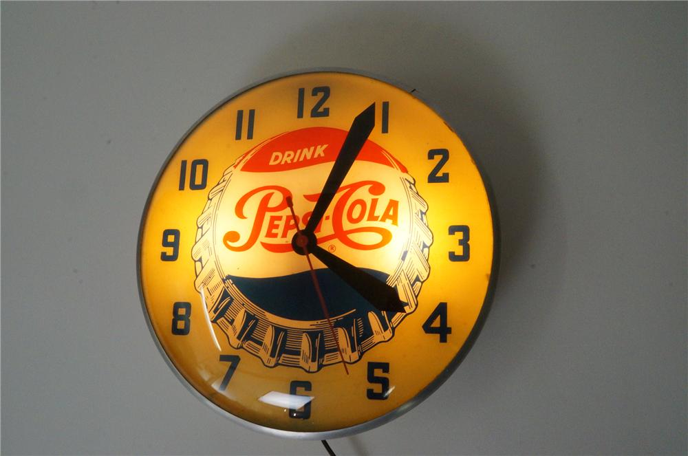 Stellar 1950s Pepsi-Cola single-dot logo glass faced light up clock by Pam clock company. - Front 3/4 - 139786