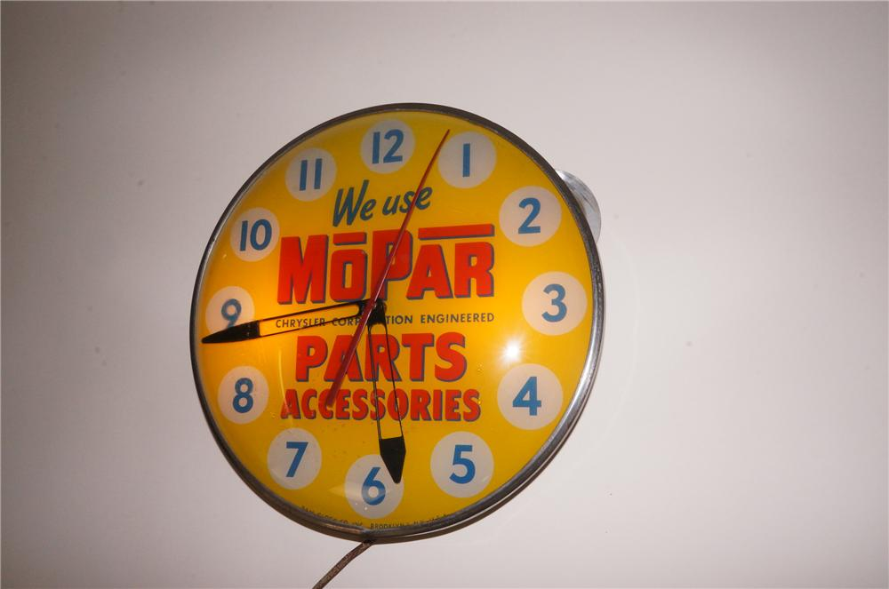Highly prized 1940s-50s Mopar Parts Accessories glass faced light-up service department clock by Pam. - Front 3/4 - 139787