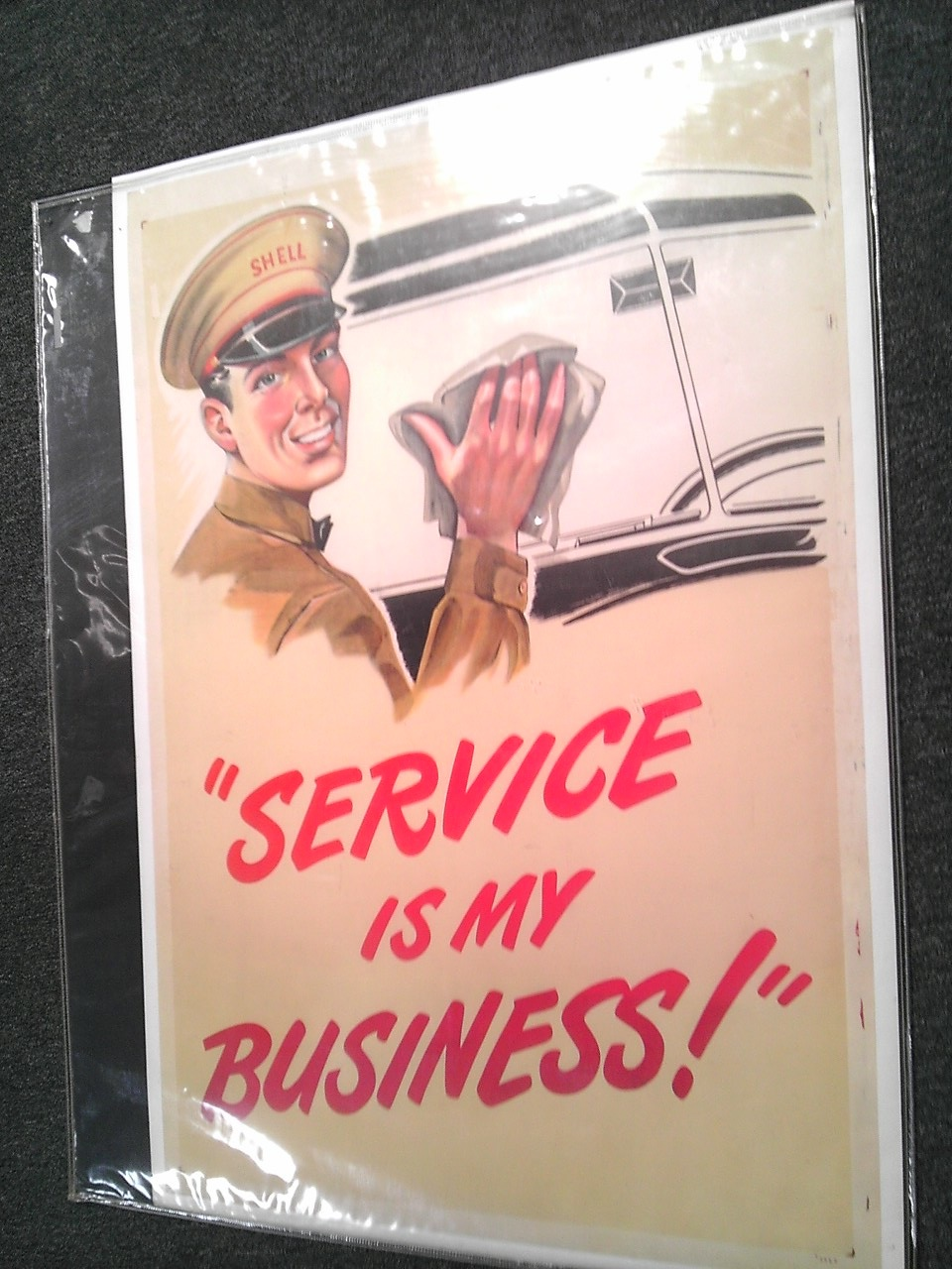 "Very neat 1930s Shell Oil ""Service is my Business"" service station poster with attendant graphic. - Front 3/4 - 139828"