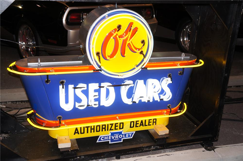 Worthy of bragging rights 1950s Chevrolet OK Used Cars double-sided neon porcelain dealership sign. - Front 3/4 - 139871