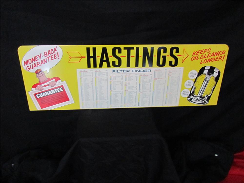 Addendum Item - N.O.S. Hastings Piston Rings and Air Filters horizontal tin sign with nice graphics. - Front 3/4 - 144234