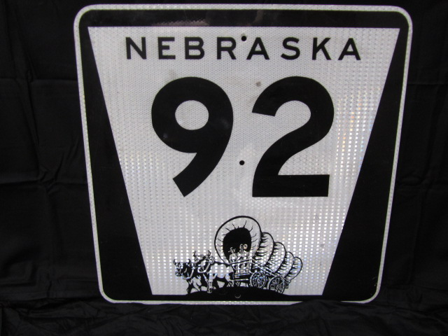 Addendum Item - Sharp vintage Nebraska 92 Highway metal road sign with Pioneer wagon logo. - Front 3/4 - 144335