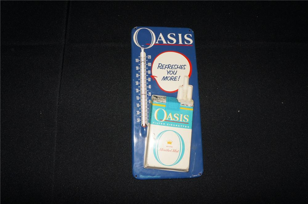 Addendum Item - 1950s-60s Oasis Cigarettes tin advertising thermometer with three dimensional cigarette pack graphic. - Front 3/4 - 145253
