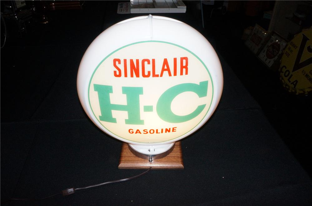 Addendum Item - Circa 1950s H-C Sinclair service station gas pump globe presented in a Capcolite body. - Front 3/4 - 145261
