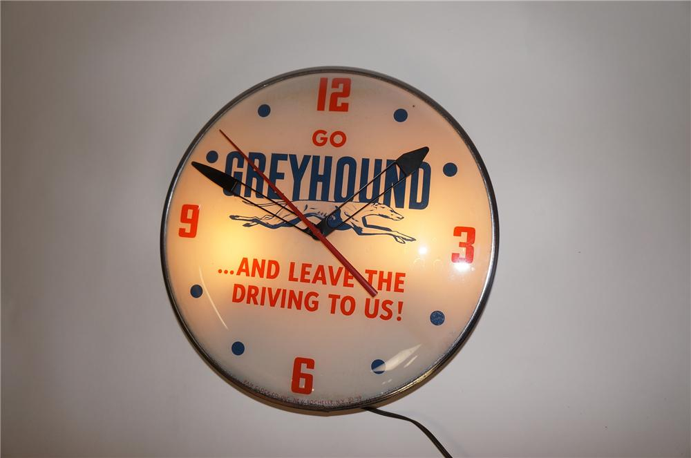 "Scarce 1950s Go Greyhound ""And Leave the Driving to Us"" glass faced light-up bus depot clock. - Front 3/4 - 151627"