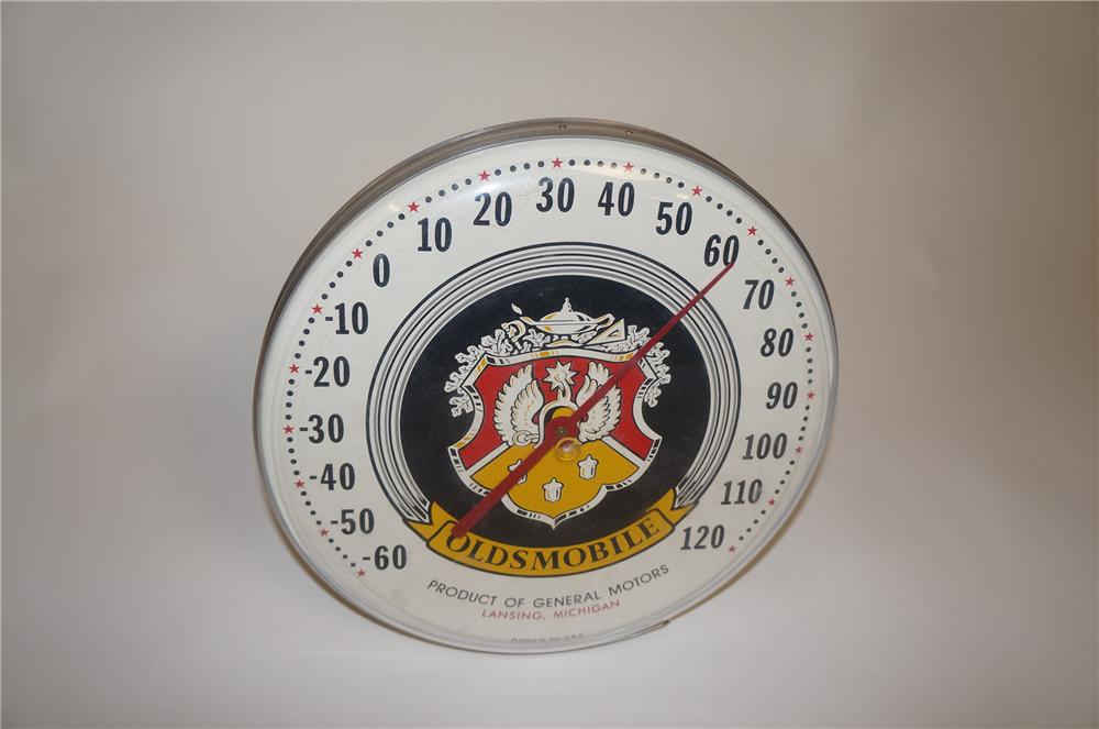 Newer 1980s Oldsmobile dealership dial thermometer with vintage logo. - Front 3/4 - 151649