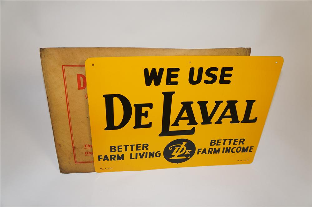 Desirable N.O.S. 1940s De Lavel Milkers single-sided tin sign found in the original shipping sleeve. - Front 3/4 - 151663