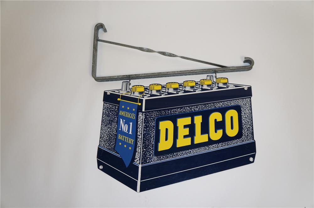 Superb N.O.S. 1950s Delco Automotive Batteries die-cut tin garage sign with hanger. - Front 3/4 - 151679