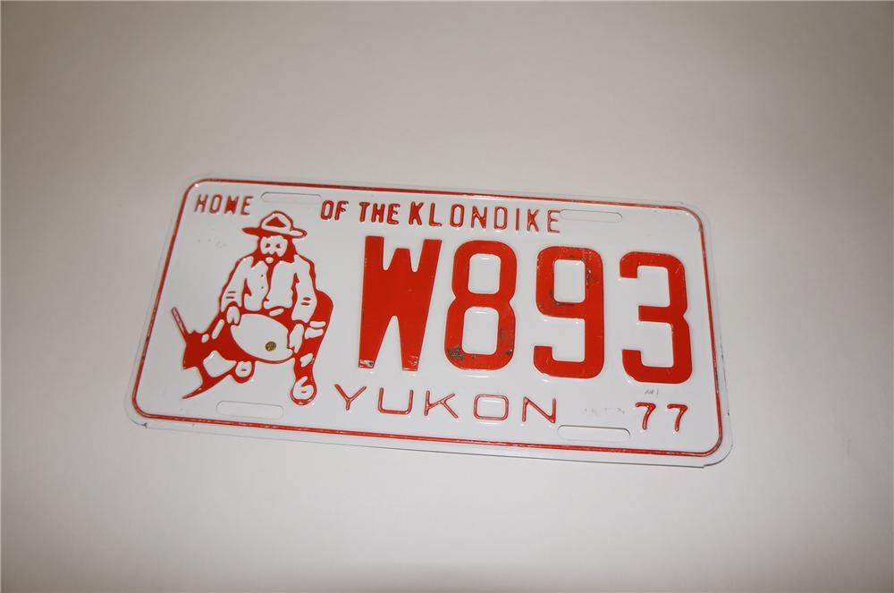 "Hard to find 1977 Yukon ""Home of the Klondike"" embossed metal license plate. - Front 3/4 - 151784"