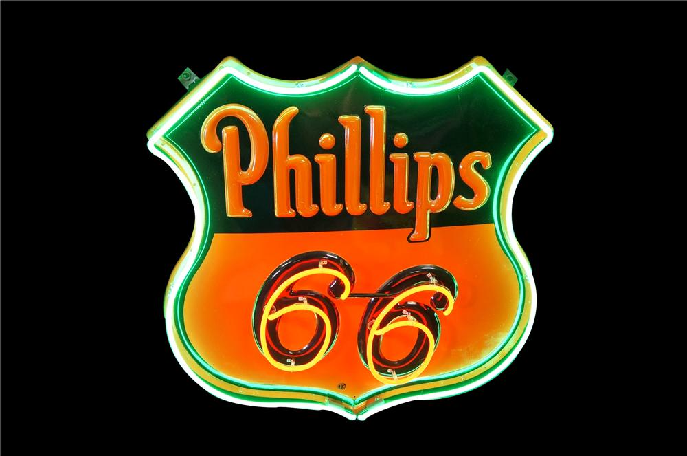 "Gorgeous 1952 Phillips 66 Oil single-sided neon porcelain shield-shaped service station sign.  ""66"" blinks on/off. - Front 3/4 - 151889"