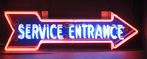 "Wonderful 1940s-50s Ford auto dealership ""Service Entrance"" single-sided porcelain neon arrow sign. - Front 3/4 - 151922"