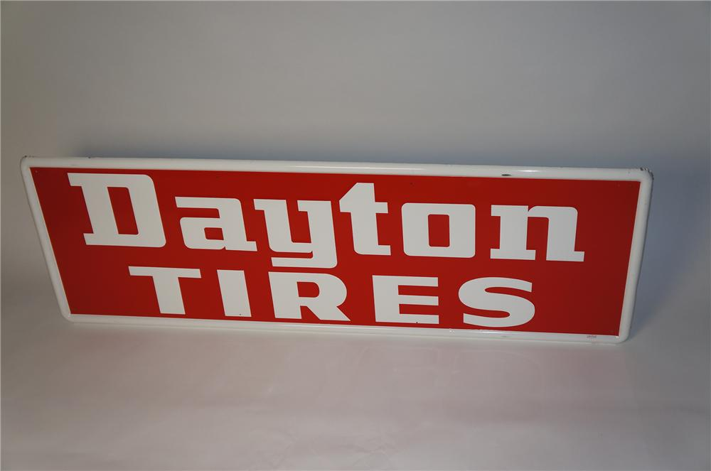 Seldom seen 1960s Dayton Tires embossed tin horizontal garage sign.  Interior face is near mint. - Front 3/4 - 154371