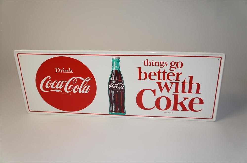 "N.O.S. late 1950s-early 1960s Drink Coca-Cola ""Things Go Better With"" horizontal tin sign with bottle graphic. - Front 3/4 - 154400"