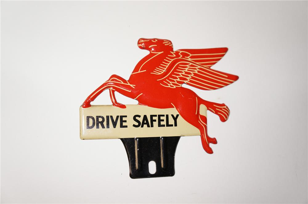 N.O.S. 1940s Mobil Drive Safely die-cut Pegasus license plate attachment sign. - Front 3/4 - 154415