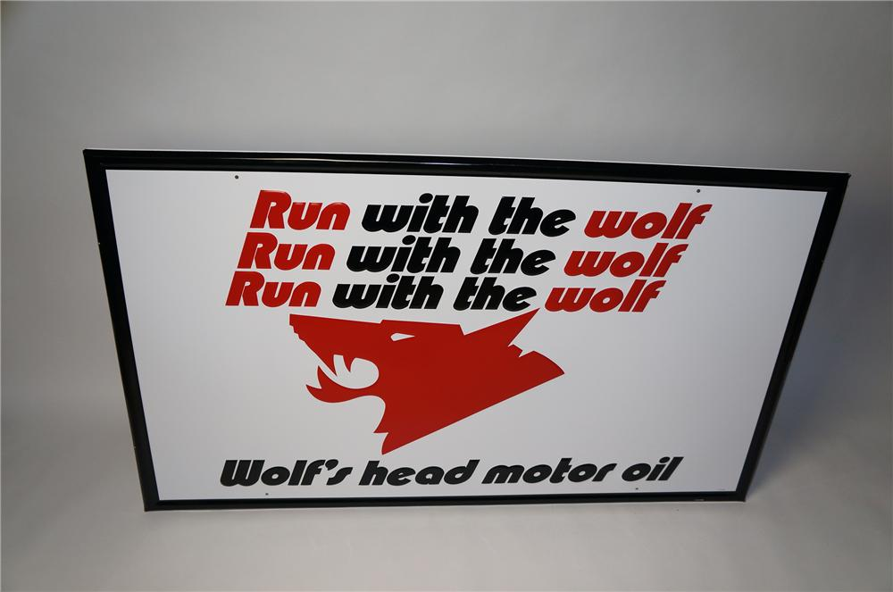 """Large N.O.S. Wolfs Head Motor Oil """"Run with the Wolf"""" self-framed embossed tin garage sign. - Front 3/4 - 154503"""