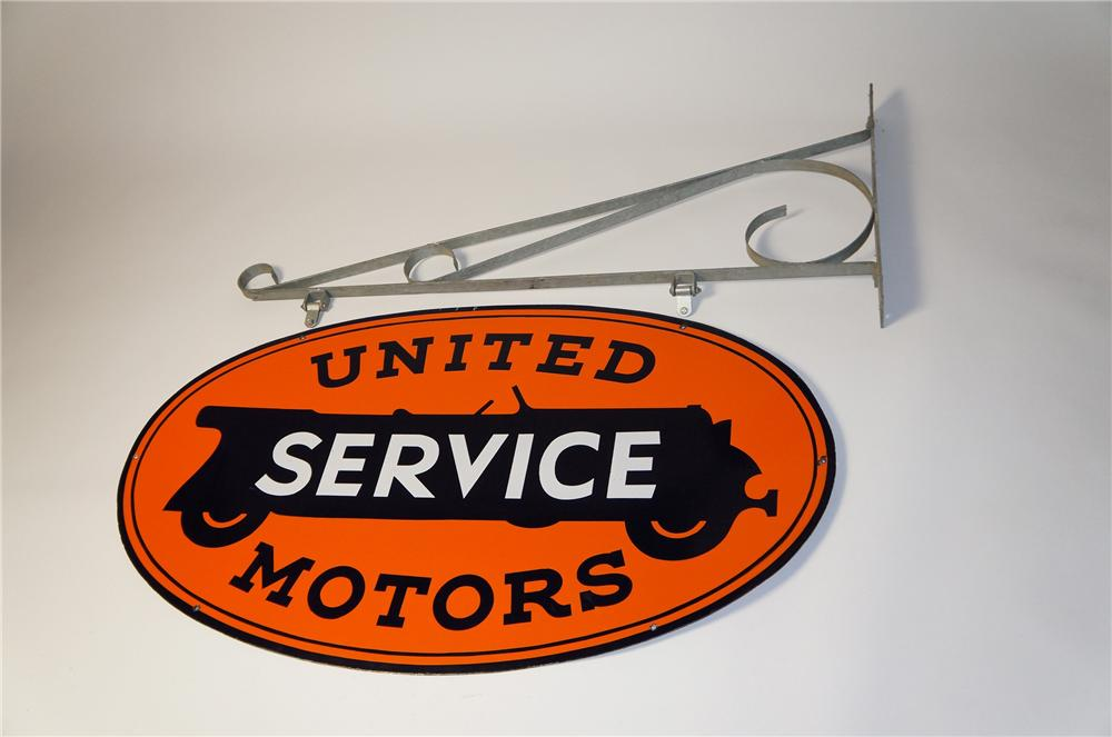 Superlative 1930s United Motors Service double-sided porcelain dealership sign with nice touring car graphics. - Front 3/4 - 154521