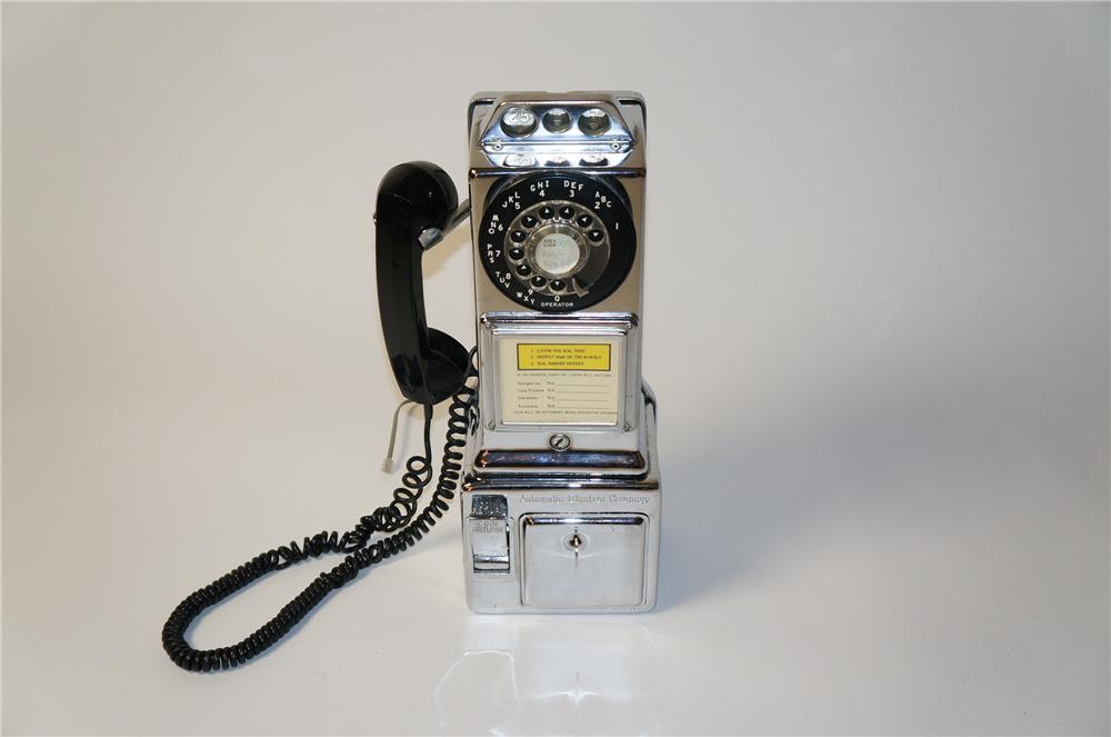 Neat vintage public pay telephone by the American Electric Company.  Appears to still work.  Nice chrome styling. - Front 3/4 - 154531