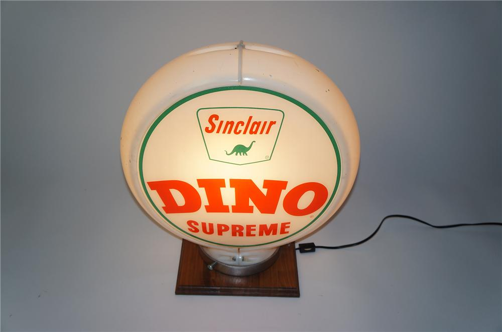 Fantastic late 1950s Dino Supreme Gasoline glass faced gas pump globe in a Capcolite body. - Front 3/4 - 154545