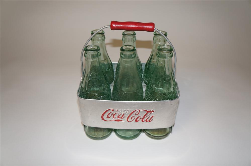 Highly desirable 1930s-40s Coca-Cola aluminum six pack carrier with six original period glass bottles. - Front 3/4 - 154554