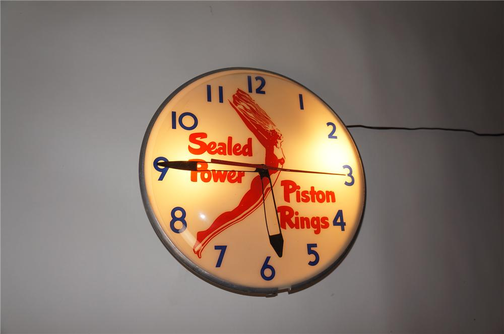 Highly prized 1950s Sealed Power Piston Rings light-up garage clock. Great graphics and condition! - Front 3/4 - 154567